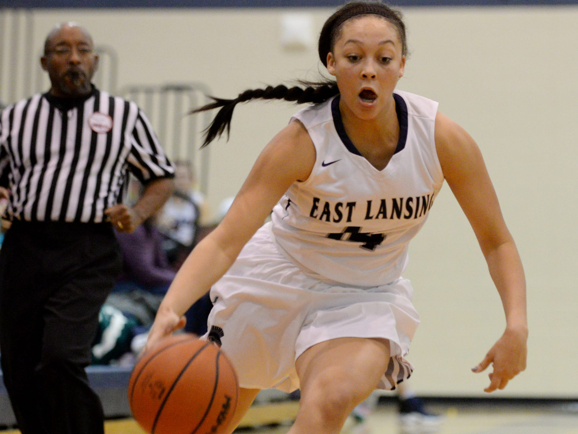 East Lansing's Aazhenii Nye runs the ball down the court during the game against Haslett on Tuesday, Dec. 13, 2016 at East Lansing High School. East Lansing won, 60-50.