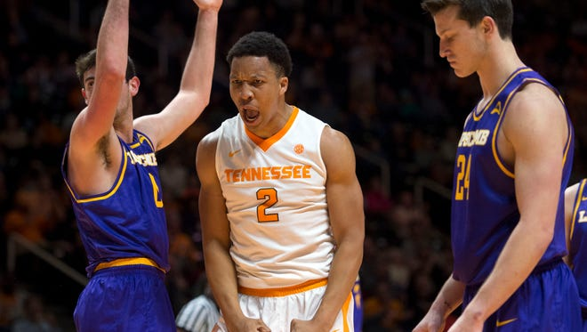Tennessee's Grant Williams yells out after drawing a foul from Lipscomb's Rob Marberry, left, while scoring  during the second half of the game on Thursday, December 15, 2016. Tennessee beat Lipscomb 92-77.