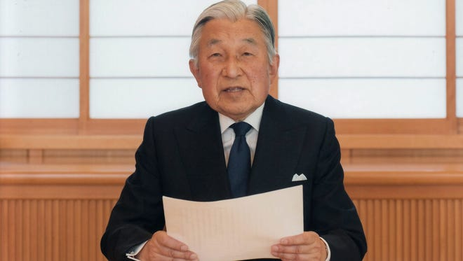A handout picture made available  by the Imperial Household Agency shows Japanese Emperor Akihito addressing a speech to the nation at the Imperial Palace in Tokyo.