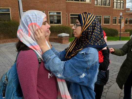 UT student Kate Conway tries on a hijab with help from Muslim Student Association member Hoor Temuri during World Hijab Day on Feb. 1, 2017. Similar events were planned worldwide and have been taking place since 2013, when a New York woman came up with the idea as a way to promote understanding and religious tolerance.