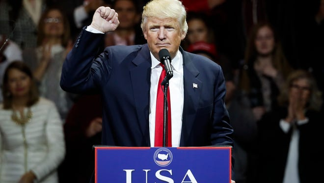 President-elect Donald Trump raises his fist as he speaks during the first stop of his post-election tour, Thursday, Dec. 1, 2016, in Cincinnati. (AP Photo/John Minchillo)