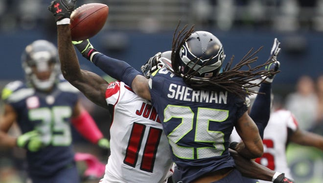 Seattle Seahawks cornerback Richard Sherman (25) defends a pass intended for Atlanta Falcons wide receiver Julio Jones (11) during the fourth quarter at CenturyLink Field.