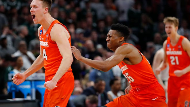 Braedon Bayer celebrates with Syracuse teammates after defeating Michigan State in the NCAA tournament on March 18, in this file photo.