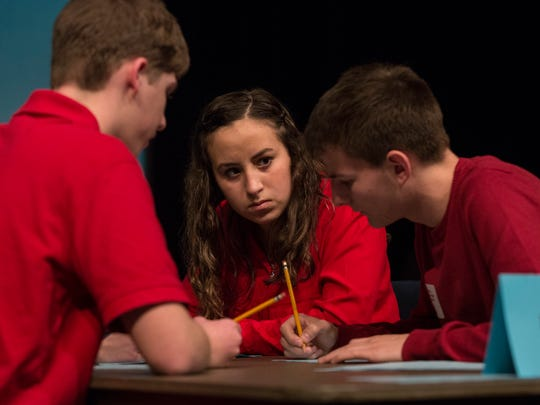 Marlette's Maggie Mutch discusses a math problem with teammates Luke Reehl, left, and Eric Poth during the Sanilac County Academic Games Saturday, Feb. 20, 2016, at St. Clair County Community College in Port Huron.