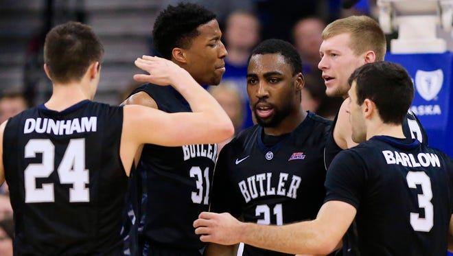 Butler players congratulate Roosevelt Jones (21) after he scored a basket in the second half of an NCAA college basketball game against Creighton in Omaha, Neb., Monday, Feb. 16, 2015. Butler won 58-56. (AP Photo/Nati Harnik)