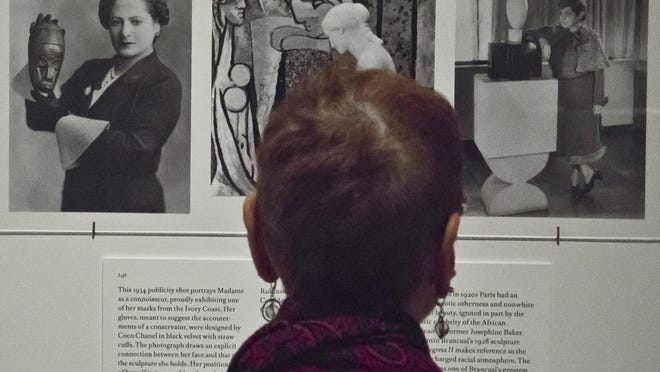 "A visitor reads about cosmetic magnate Helena Rubinstein during a media preview of the exhibition ""Helena Rubinstein: Beauty is Power,"" at the Jewish Museum in New York. Also known as Madame, Rubinstein, who died in 1965, collected African, Oceanic and Latin American art along with commissioned paintings of herself and drawings by Picasso. The exhibition runs through March 22 next year."