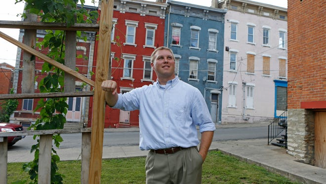 Matt Jacob is photographed near his home near the intersection of Lang Street and E. Clifton Avenue in Over-the-Rhine Monday June 23, 2014.