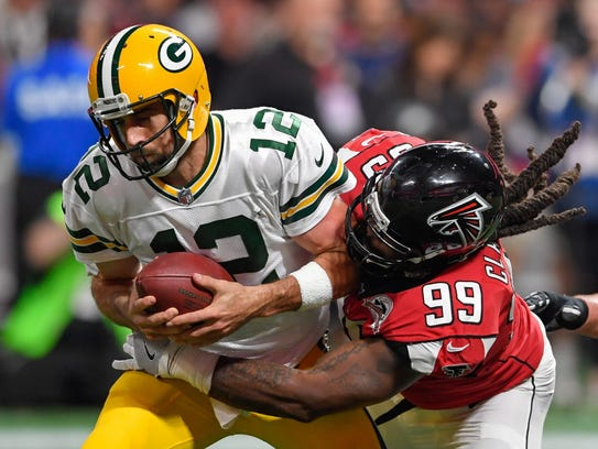 Packers quarterback Aaron Rodgers is sacked by Falcons