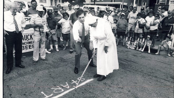 Former Louisville Mayor Jerry Abramson gives instructions to Sister Gertrude of the Little Sisters of St. Joseph's Home at the 21st Annual Dainty Contest in 1991 on Goss Avenue in Schnitzelburg.
