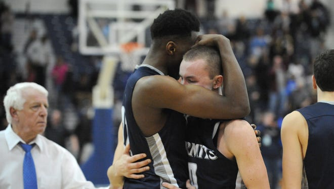 Justyn Mutts, left, consoles teammate Austin Kennedy after St. Augustine Prep fell to Don Bosco Prep in the Non-Public A state final Saturday nigt.