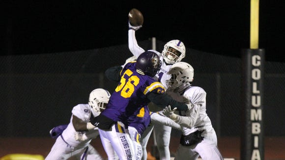 New Rochelle's Jonathan Saddler releases a pass during a Class AA state quarterfinal with Troy at Columbia High School Nov. 10, 2017. Troy won 17-14.