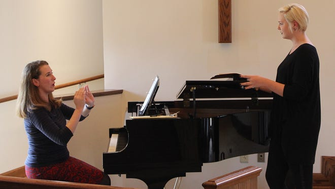 Professional opera singer Emily Hindrichs, left, hosts a master class at William Carey University.