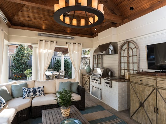 The veranda was designed with entertaining in mind. It features a gas grill, a TV and plenty of comfortable seating.