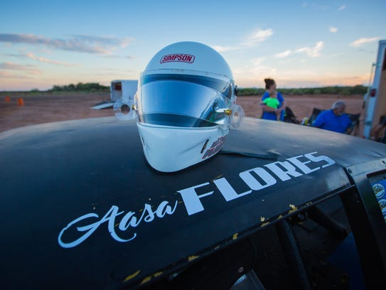 "Aasa ""Boo"" Flores' helmet sits atop the car the 11-year-old"