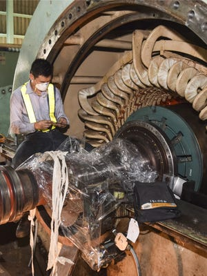 In this March 2016 file photo, a worker checks on the rotor, stator and windings during an overhaul of the Cabras Unit 2 generator. The power agency shut down the Cabras 1 generators July 15 for a similar overhaul. A proposed settlement with the federal government would require GPA to retire the generators Oct. 31, 2022, which means GPA must determine what to do with the 50 people who currently work at Cabras.
