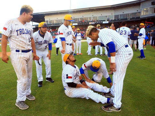Moody players celebrate after defeating Ray in game 2 of the Region IV-5A finals Friday, June 2 ,2017, at Whataburger Field in Corpus Christi.