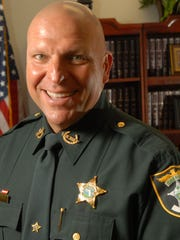 Lee County Sheriff Mike Scott faces James Didio, who