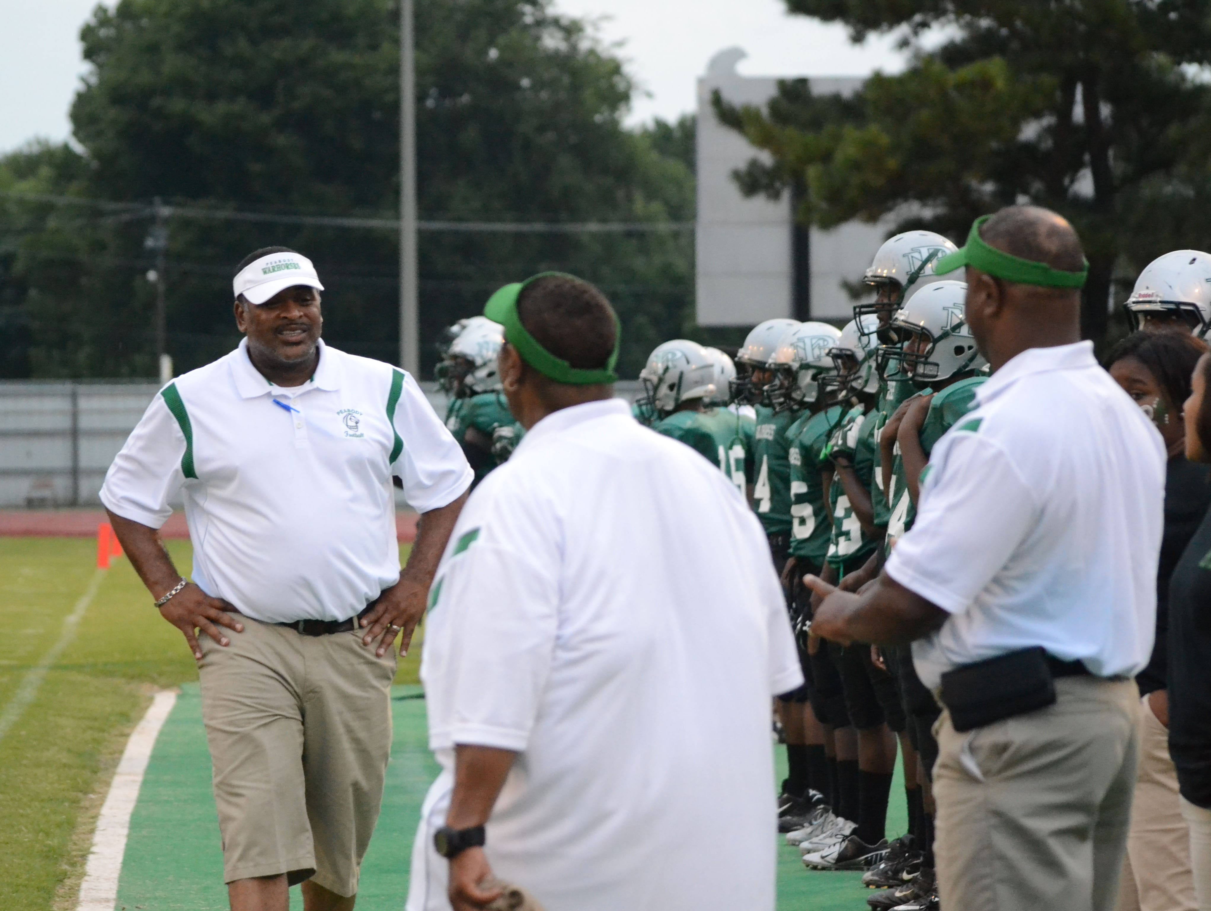 Toriano Williams (left), who was the All-Cenla Football Coach of the Year after leading Peabody to its first playoff win in five decades last year, was fired Wednesday after just one season with the Warhorses.