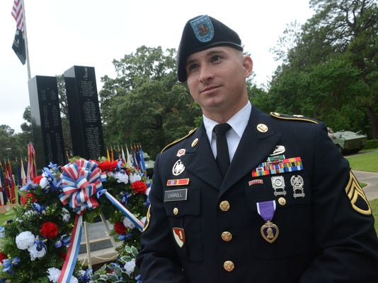 ANI Purple Heart Recipient Staff Sgt. Alan M. Carroll, 3rd Brigade Combat Team, 10th Mountain Division out of Fort Polk, was wounded during the deadly attack by Maj. Nadal Hassan at Fort Hood, Texas. He received the Purple Heart Thursday, May 21, 2015, dur