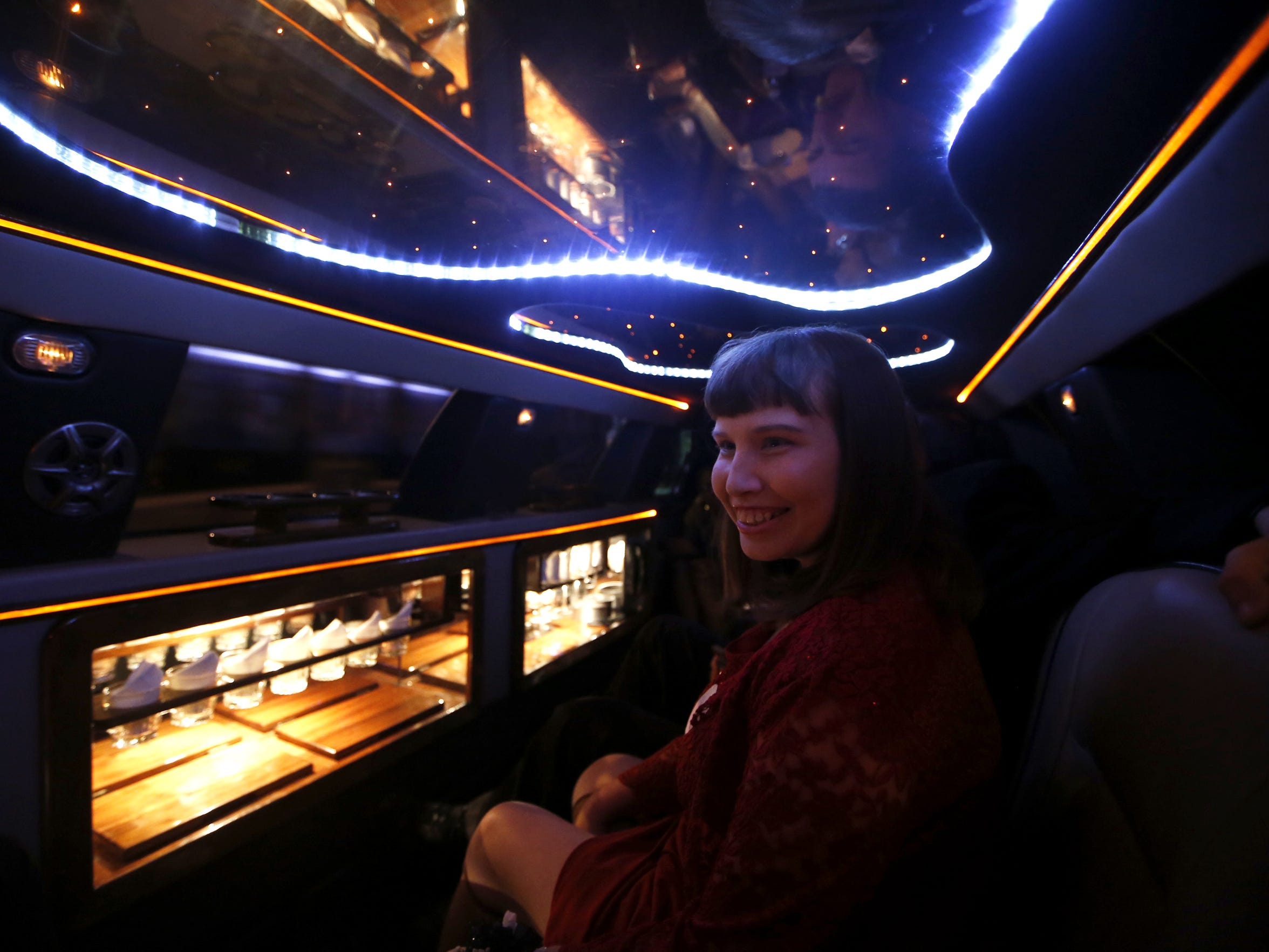 Tasha Mathis smiles over at Charlie during their limo ride, part of the activities during the Night to Shine special needs prom at the Genesis Church on Friday, Feb. 12, 2016.