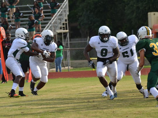 Peabody senior running back Bruce Price (24) takes a handoff in the Cenla Jamboree in August.