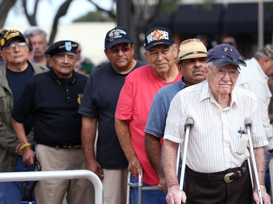 Paul Alaniz Sr. (right) lines up with other veterans to be recognized during the Vietnam Veterans Day Ceremony at the Fallen Heroes Memorial at the Nueces County Courthouse on Wednesday, March 29, 2017. Alaniz served in the Army, Air Force and Navy. He was on his way to Vietnam when he found out his son had been killed in Vietnam.