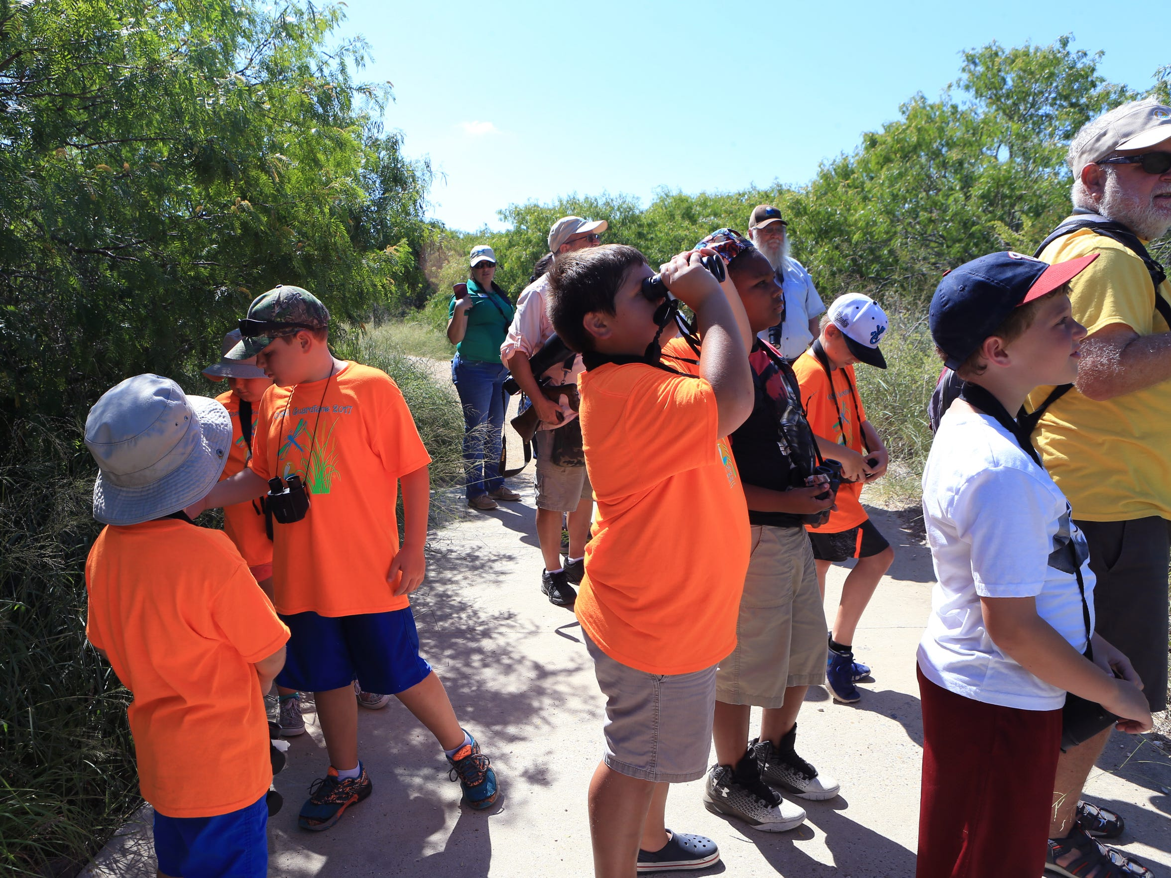 Nature campers participating in the O.S.O. Guardians Camp at the Oso Bay Wetlands Preserve and Learning Center pause during a nature hike to look at birds on Wednesday, June 21, 2017. The theme for this week's camp is I Spy Wildlife. Campers gain and understanding of the environment and wildlife found in the Coastal Bend.
