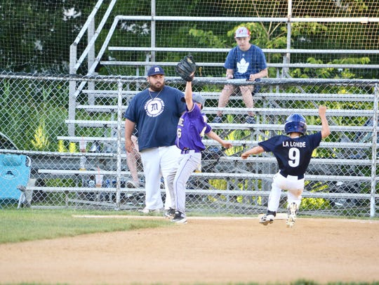 Finlay La Londe (9) slides into third base against