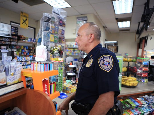 Duval County Sheriff Lt. Johnny Perez talks with a clerk at the Kwik Pantry in Benavides on Tuesday, August 8, 2017. A donation from The Wyatt Foundation will allow the department to do more community policing.