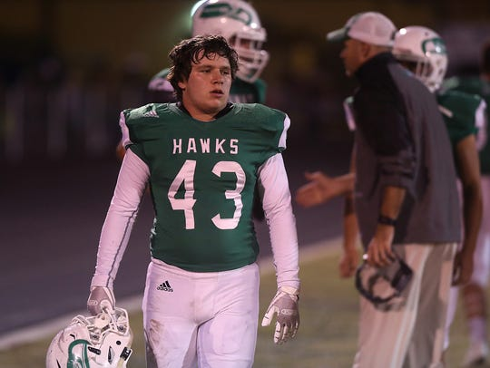 Wall's Lucas Garcia watches the game against Midland