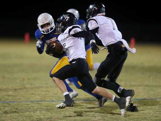 Water Valley's Caleb West makes a play for the end