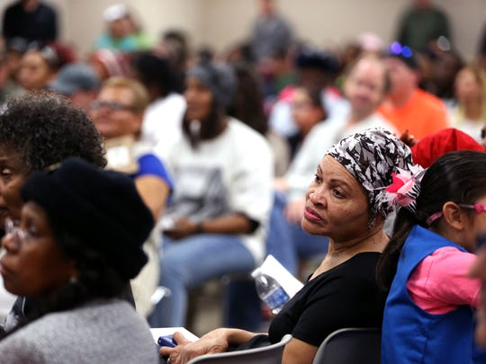 Participants in the 32nd annual Martin Luther King Holiday Celebration MLK Commemorative March listen to speakers before the start of the march at the Nueces County Courthouse on Monday, January 15, 2018.