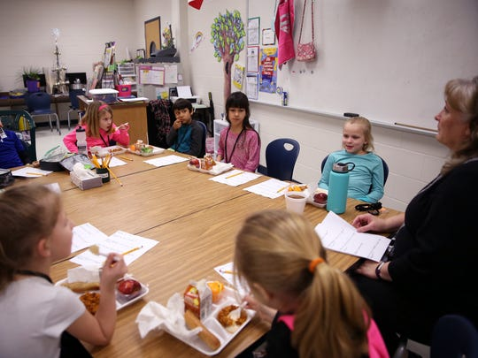 Robin Johnson (far right) talks with second-grade gifted