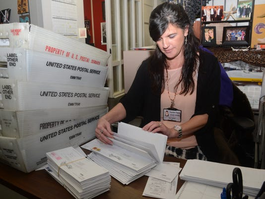 ANI Elections Ballots Sherri Melder, an administrative assistant at the Registar of Voters Office at the Rapides Parish Courthouse, goes through mail-in ballots Wednesday, Dec. 3, 2014. -Melinda Martinez/mmartinez@thetowntalk.com, The Town Talk, Gannett