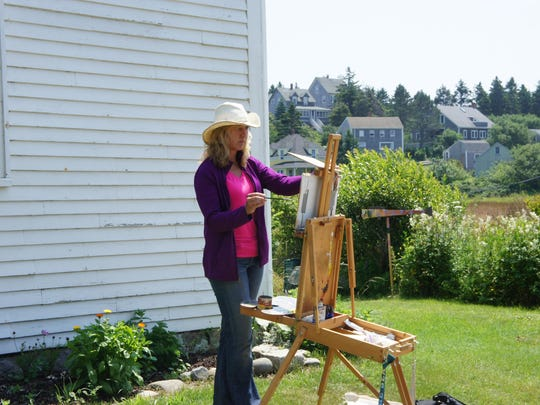 Monhegan's stunning natural beauty and tranquility has inspired generations of painters for more than a century in Maine. Here artist Joan Brady works on her latest masterpiece.