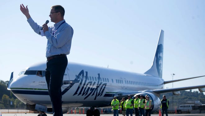 Alaska Airlines CEO Brad Tilden speaks to the crowd during the Alaska Airlines Plane Pull benefiting Strong Against Cancer at The Museum of Flight in Seattle on July 28, 2015.