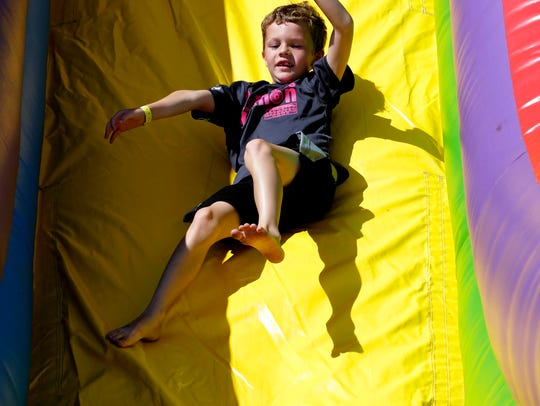 Alex Parker, 7, of Marshfield, flies down the slide