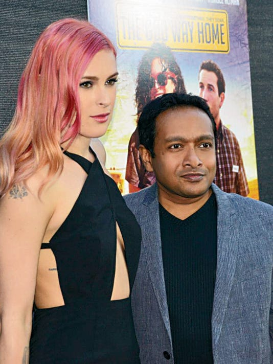 """Rajeev Nirmalakhandan joins """"The Odd Way Home"""" star Rumer Willis at the film's red carpet Hollywood premiere. Nirmalakhandan directed and co-wrote the film with Jason Ronstadt."""