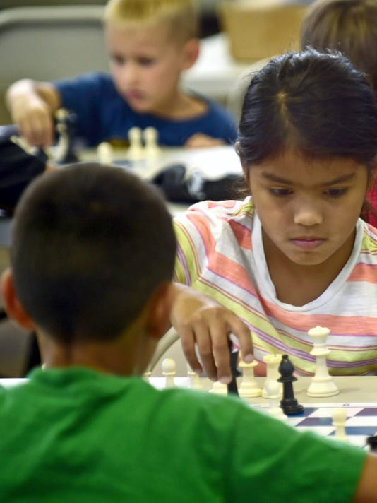 Habassah Deleon, 8, takes moves during a match with her brother, Lucas, 9, during chess camp at Montessori Academy, on Tuesday, July 21, 2105.