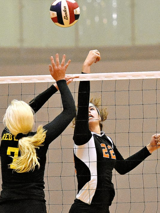 Central York's Emily Poole, right, hits the ball across the net while Red Lion's Lindsey Blevins, left, defends during girls' volleyball action at Central York High School on Wednesday. Central York would win the match, 3-2.