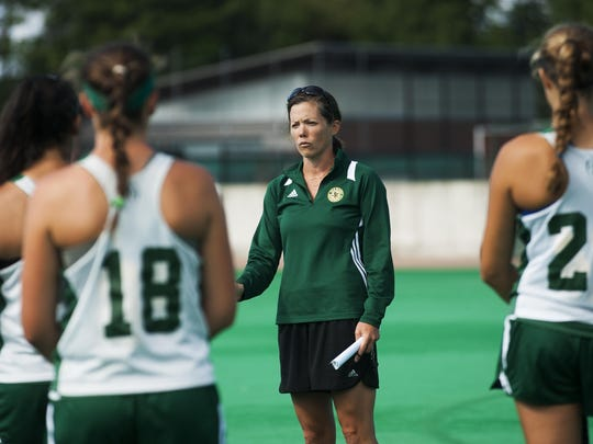 Head coach Kate Pfeifer talks to the team during the UVM field hockey practice at Moulton Winder Field on Wednesday morningin Burlington.