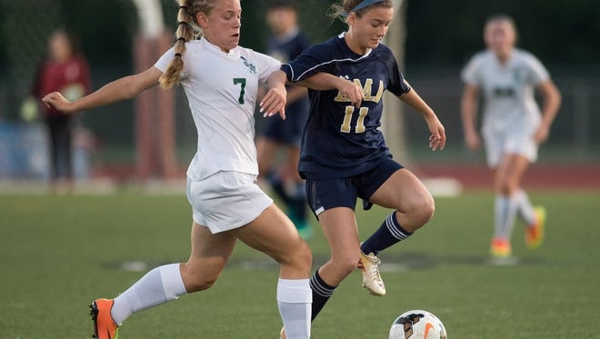 Tower Hill's Laura Taschner (7) and Delaware Military Academy's Melayna Immediato (11) battle for the ball during the DIAA division II girls soccer semifinals at Appoquinimink High School.