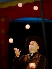 Nicolas Souren juggles multiple balls during The Kelly Miller Circus performance at Kelleys Island on Monday evening.