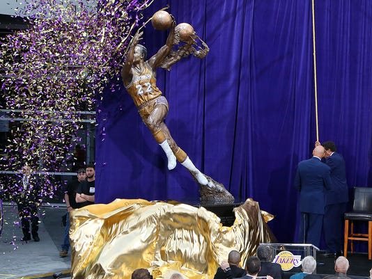 A statue honoring Minneapolis and Los Angeles Lakers great Elgin Baylor is unveiled outside Staples Center in Los Angeles on Friday, April 6, 2018. (AP Photo/Reed Saxon)