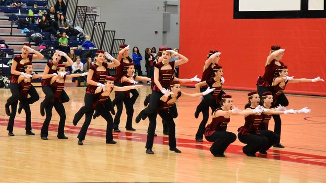 The Canton varsity pompon squad performs its first-place bellhops routine at the recent Mid-American Pompon High Kick competition at Saginaw Valley University. From left are Tara Quigley, Grace Brekke, Abby Crippes, Mia Tavian, Maigan Byars, Aleigh Gorham, Madison Santori, Gabby Watts, Stacey Partain, Alicyn Mabry, Brenna Shaw, Emily Cesario, Emma Stevens, Sophie Mekled, Clara Mason, Ayden Peters, Morgan Fillmore, Katie Valchine and Shelby Petersen.