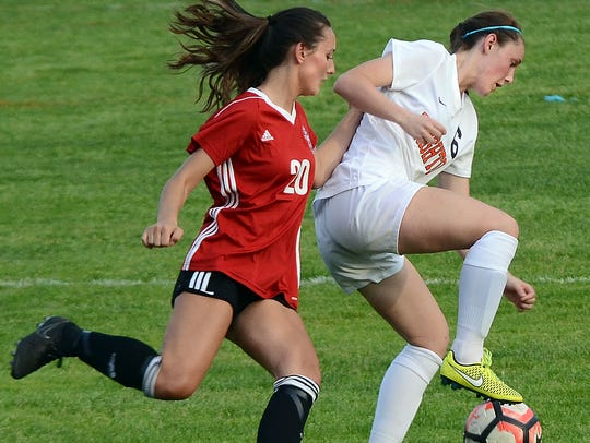 Brighton's Abbie Bowland controls the ball while being