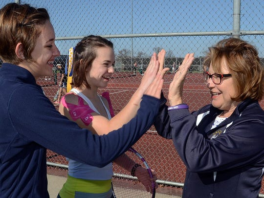Hartland tennis coach Judy Jagdfeld high-fives her