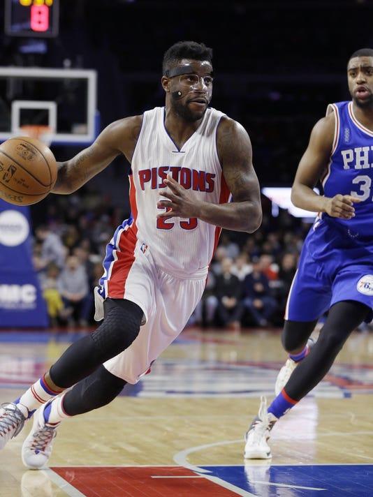 6328f0035 Detroit Pistons  Reggie Bullock and teammates enjoy his big night