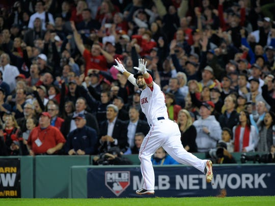 Shane Victorino (18) reacts after hitting a grand slam