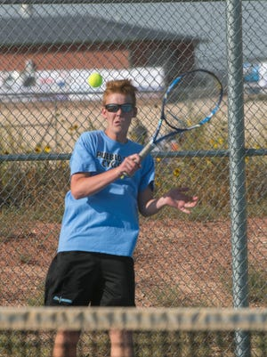Pueblo West High School senior Brendan Bradfield returns a shot during a dual last season.  Bradfield was the Cyclones No. 1 singles player last year and retuns to lead the team this year.